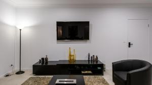 A television and/or entertainment center at Onestep Airlie Retreat