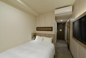 A bed or beds in a room at Hotel Il Fiore Kasai