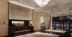 The lobby or reception area at NJV Athens Plaza