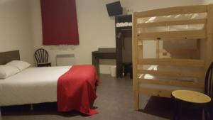 A bunk bed or bunk beds in a room at Relax Hotel