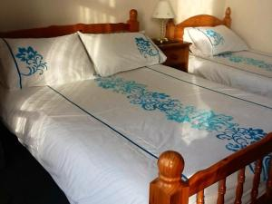 A bed or beds in a room at Alcorn Guest House