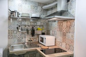 A kitchen or kitchenette at Santa Chiara Loft