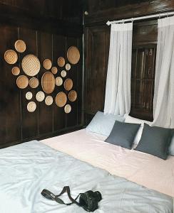 Giường trong phòng chung tại Diagon Alley Homestay