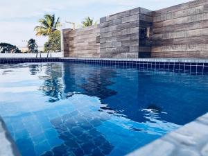 The swimming pool at or near Pousada da Praia