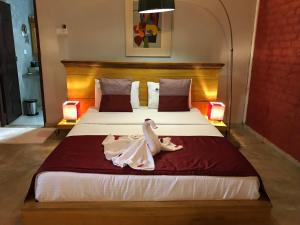 Een bed of bedden in een kamer bij Hotel Heladiv