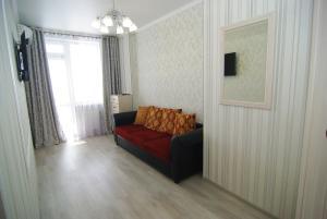 Гостиная зона в Apartment on Revkomovsky 4