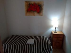 Una cama o camas en una habitación de Faros de Sol
