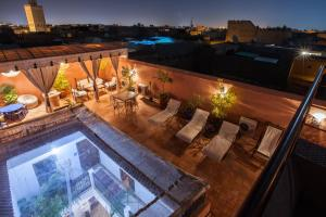 A view of the pool at Riad Thycas or nearby
