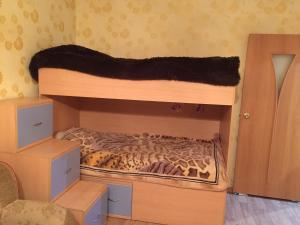 A bunk bed or bunk beds in a room at Апартаменты на Вихрева, 82