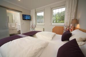 A bed or beds in a room at Landidyll Landhaus Liesetal