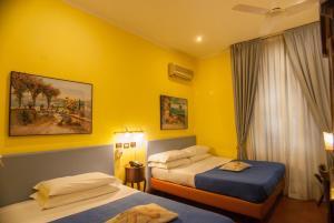 Un ou plusieurs lits dans un hébergement de l'établissement Hotel Toledo