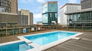 The swimming pool at or near Renovated Central CBD Studio CLDN4