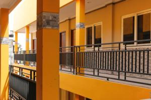 A balcony or terrace at RedDoorz Plus near Palembang Square Mall