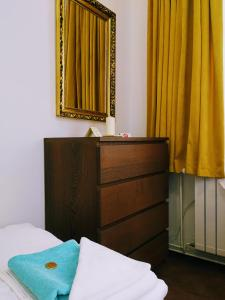 A bed or beds in a room at Hotel Villa Ostrava 3+