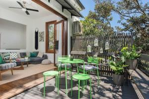 A restaurant or other place to eat at Historic 1890s House With Terraced Backyard Deck