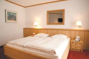 Ein Bett oder Betten in einem Zimmer der Unterkunft Akzent Hotel Deutsche Eiche