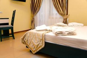 Кровать или кровати в номере Гостиница ЛЭНСиС