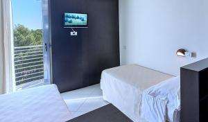 Letto o letti in una camera di Hotel Lido