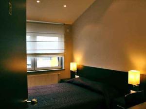 Ein Bett oder Betten in einem Zimmer der Unterkunft Hotel il Castello Borghese