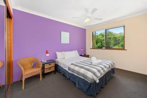 A bed or beds in a room at Port Macquarie Seychelles