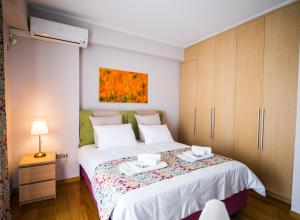 A bed or beds in a room at National Opera Apartment