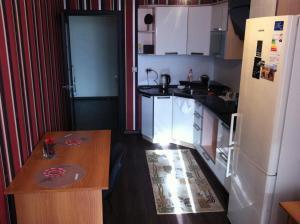 A kitchen or kitchenette at Apartments ''Cube'' - Dimitrova 110 G