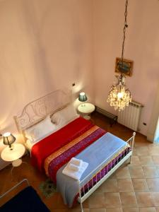 A bed or beds in a room at Residenza Napoli Centro