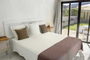 A bed or beds in a room at Casa La Siesta