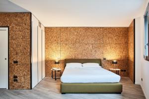 Ein Bett oder Betten in einem Zimmer der Unterkunft La Perla by Sedar