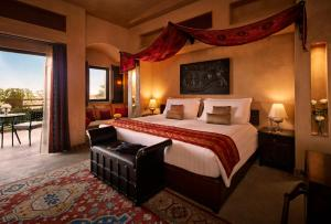 A bed or beds in a room at Bab Al Shams Desert Resort and Spa