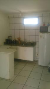 A kitchen or kitchenette at Residence Porto de Iracema