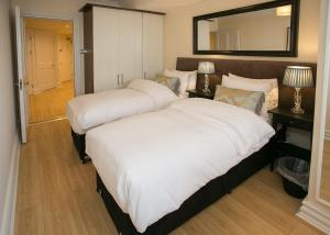 A bed or beds in a room at O'Connell Bridge Apartments