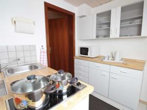 Kuchyň nebo kuchyňský kout v ubytování Ferienwohnung Nain