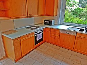 A kitchen or kitchenette at City Apartment East Side