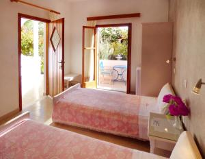 A bed or beds in a room at Villa Georgia