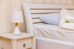 Кровать или кровати в номере Zvenigorod cottage Sadovaya