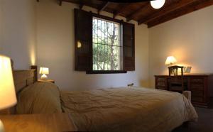 Una cama o camas en una habitación de Cabañas Estancia Balumba