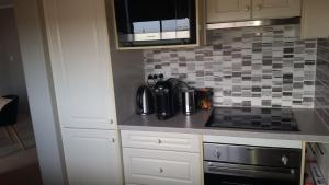 A kitchen or kitchenette at Brighton-Le-Sands Beachside