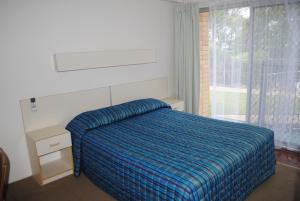 A bed or beds in a room at Motel Miramar