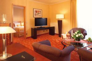 Телевизор и/или развлекательный центр в Vital Hotel