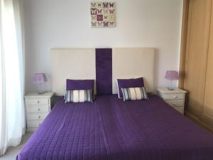 Uma cama ou camas num quarto em Silver Coast Holidays