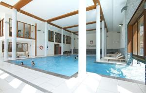 The swimming pool at or near Appart'Hotel Prestige Odalys Eden