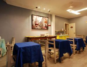 Um restaurante ou outro lugar para comer em Pousada Garoupa