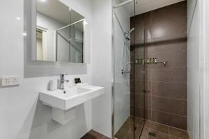 A bathroom at Astra Apartments Newcastle