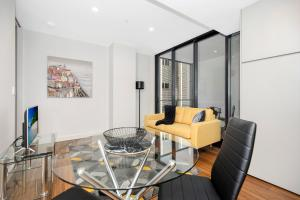 A seating area at Astra Apartments Newcastle