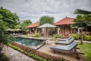 The swimming pool at or near Global Royal Pemuteran