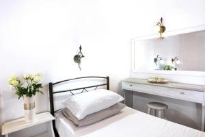 Ένα ή περισσότερα κρεβάτια σε δωμάτιο στο Poseidon Villas