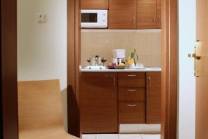 A kitchen or kitchenette at Rodian Gallery Hotel Apartments