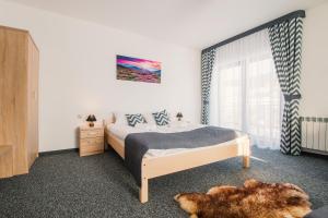 Łóżko lub łóżka w pokoju w obiekcie Villa Cicho Sza
