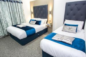 A bed or beds in a room at Abbey Hotel